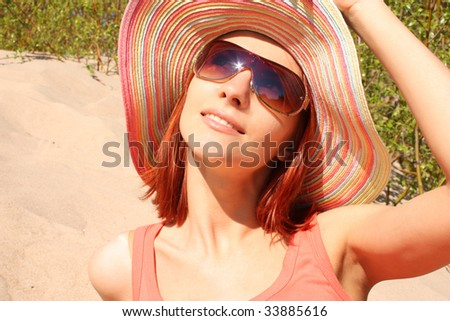 Portrait of smiling beautiful woman in hat