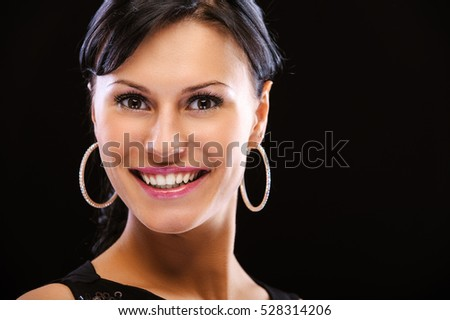 Portrait of smiling beautiful woman, isolated on black background.