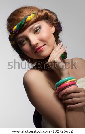 portrait of smiling beautiful young woman on white - stock photo