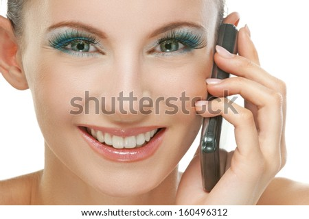 Portrait of smiling beautiful young woman with phone isolated on white background. - stock photo