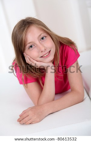 Portrait of smiling blond girl - stock photo