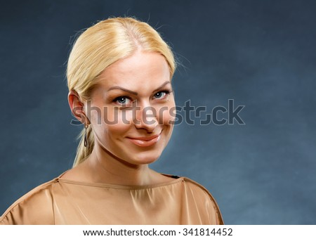 Portrait of smiling blonde beautiful woman - stock photo
