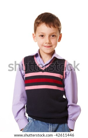 Portrait of smiling boy looking at camera over white background - stock photo