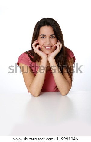 Portrait of smiling brunette girl wearing pink shirt - stock photo