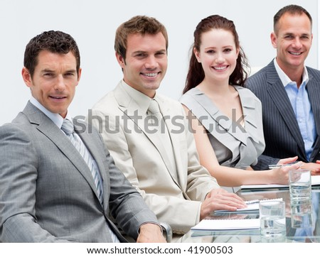 Portrait of smiling business people sitting in a meeting