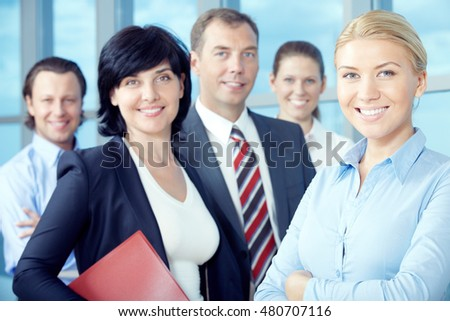 Portrait of smiling business team looking at camera