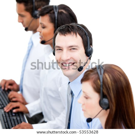 Portrait of smiling business team with  headset on against white background - stock photo