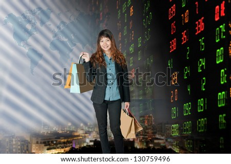 Portrait of smiling business woman.over stock exchange background - stock photo