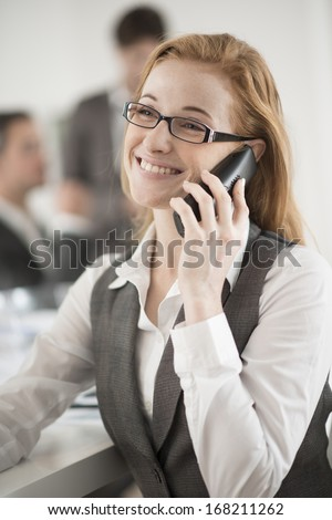 portrait of smiling businesswoman at phone
