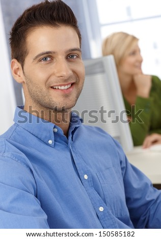 Portrait of smiling casual office worker man looking at camera. - stock photo