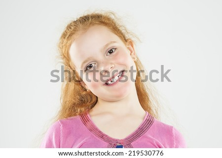 Portrait of Smiling Caucasian Redhaired Little Girl.Standing Against White.  Horizontal Image Composition - stock photo