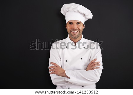 Portrait of smiling chef in uniform  - stock photo