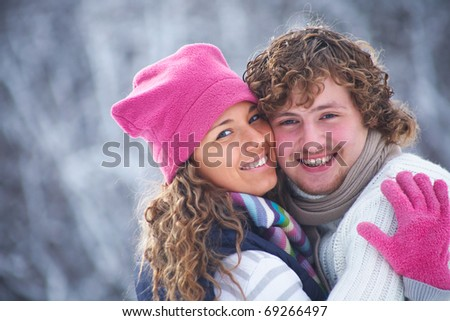 Portrait of smiling couple in winter park