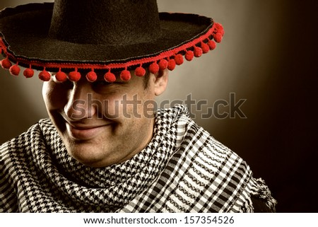 Portrait of smiling cowboy mexican - stock photo