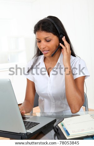 Portrait of smiling customer service operator - stock photo