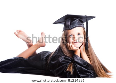 Portrait of smiling cute girl in black academic cap and gown on isolated white - stock photo