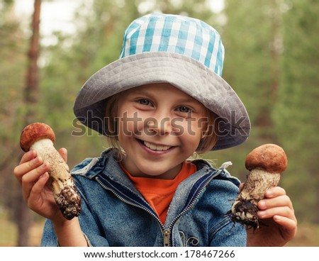 Portrait of smiling cute little girl in a park. Close-up of beautiful child, outdoors - stock photo