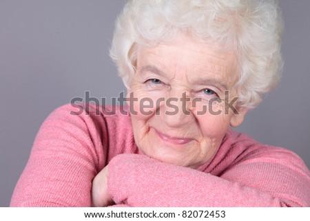 portrait of smiling elderly woman - stock photo