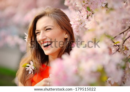 Portrait of smiling face Beautiful brunette woman in spring trees background