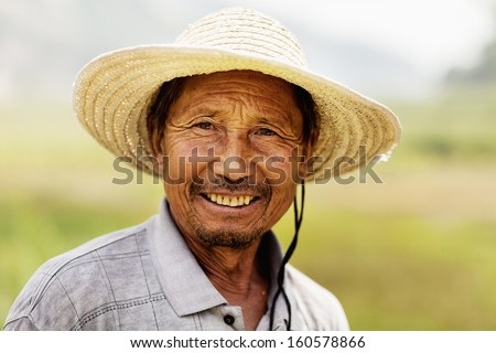 Portrait of smiling farmer - stock photo