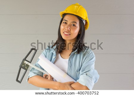 portrait of smiling female construction worker