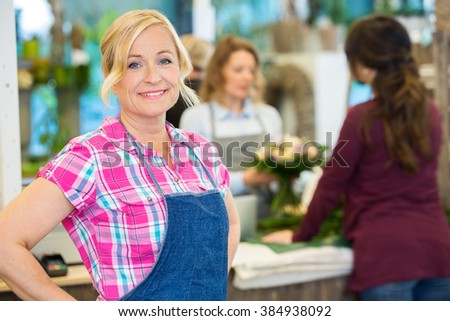 Portrait Of Smiling Female Florist In Shop - stock photo