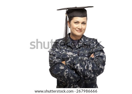 Portrait of smiling female navy sailor with graduation cap against white background - stock photo