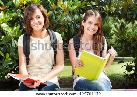 Portrait of smiling female students - stock photo