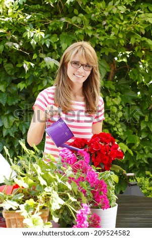 Portrait of smiling flower shop owner standing at desk. Small business.   - stock photo