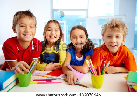 Portrait of smiling friends enjoying their day at school - stock photo