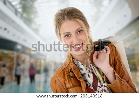 Portrait of smiling girl in a shopping mall - stock photo