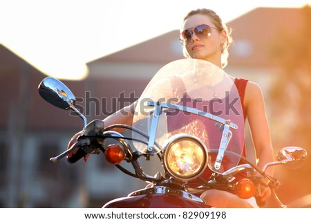 Portrait of smiling girl on scooter - Outdoor on street .Retro shot. Fashion art photo