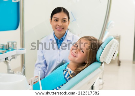 Portrait of smiling girl ready to have dental examination - stock photo