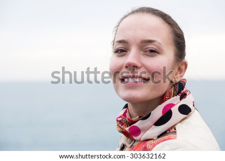 Portrait of smiling girl relaxing at berth in winter day - stock photo