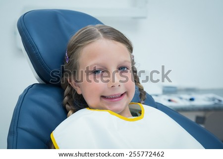 Portrait of smiling girl waiting for a dental exam - stock photo