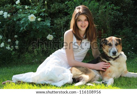 Portrait of smiling girl with her dog . Friendship concept.