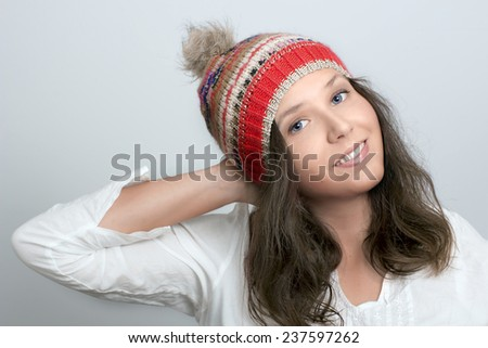 Portrait of smiling girl  with knitted hat