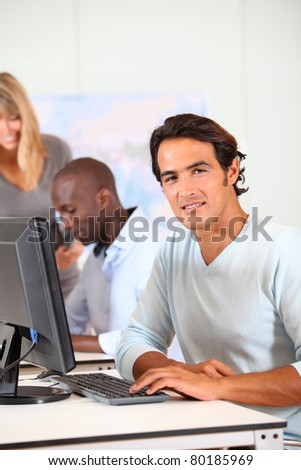 Portrait of smiling handsome man in office