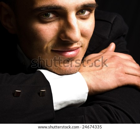 Portrait of smiling handsome man with sensual eyes - stock photo