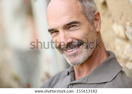 Portrait of smiling handsome mature man - stock photo