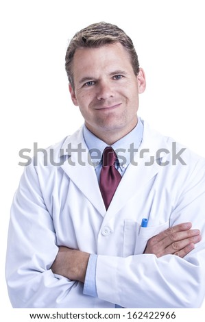 Portrait of smiling handsome young Caucasian doctor in lab coat with ...