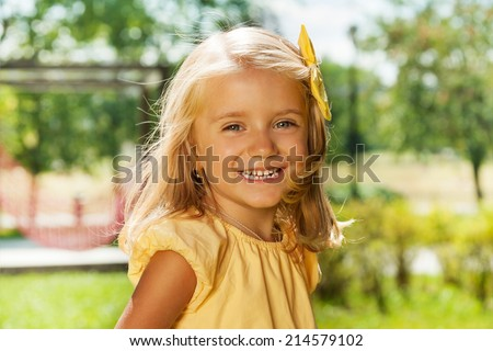 Portrait of smiling happy blond little girl  - stock photo