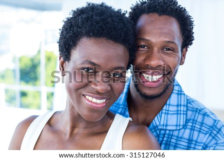 Portrait of smiling happy couple at home - stock photo