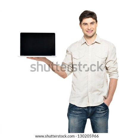 Portrait of smiling happy man holds laptop on palm with blank screen - isolated on white. Concept communication. - stock photo