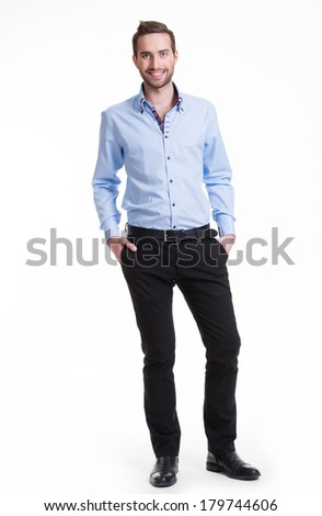 Portrait of smiling happy man in blue shirt and black pants - isolated on white.  - stock photo
