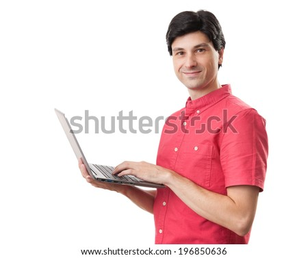Portrait of smiling happy man with laptop isolated on white