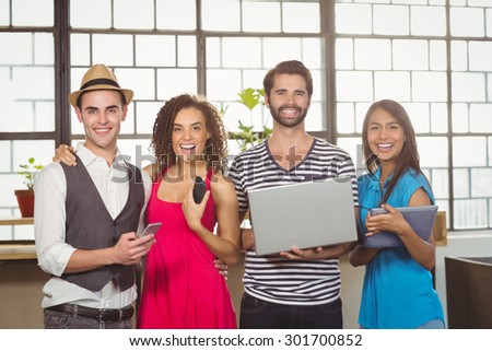 Portrait of smiling holding different types of multimedia