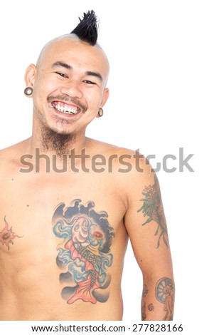 portrait of smiling laughing asian punk guy with mohawk hair style, piercing and tattoo isolated on a white background - stock photo