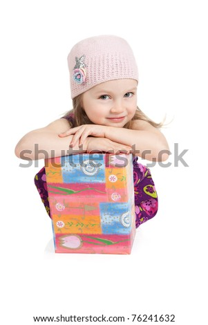 Portrait of smiling little girl in a pink hat with gift box over white - stock photo