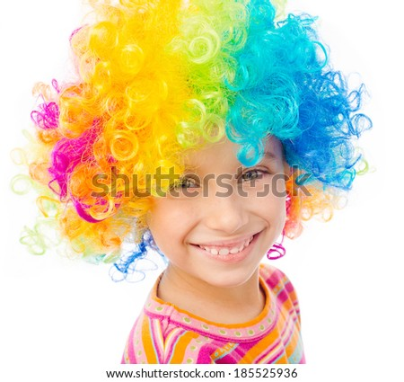 portrait of smiling little girl in clown wig isolated on white background - stock photo